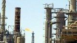IS tấn công dữ dội vào thị trấn lọc dầu lớn nhất Iraq