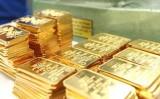 Giá vàng thế giới tụt dốc, trong nước ít biến động