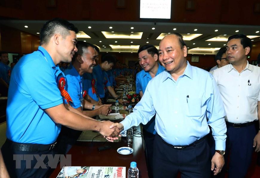 Thủ tướng Nguyễn Xuân Phúc gặp gỡ với công nhân, lao động kỹ thuật cao năm 2019. (Ảnh: Thống Nhất/TTXVN)