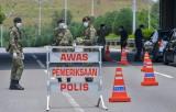 Malaysia kéo dài lệnh hạn chế đi lại đến giữa tháng Tư
