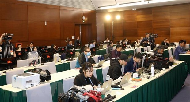 Reporters of foreign news agencies work at 13th National Party Congress's press centre (Photo: VNA)