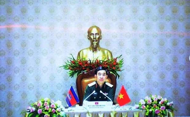 Bộ trưởng Quốc phòng Việt Nam Phan Văn Giang tham dự cuộc trao đổi trực tuyến từ đầu cầu Việt Nam. (Ảnh: Trần Long/TTXVN)
