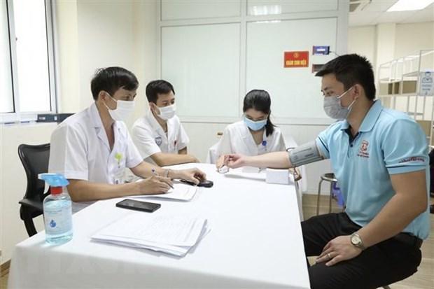 Khu vực khám sàng lọc trước tiêm cho các tình nguyện viên tham gia tiêm thử nghiệm đợt 3 vaccine Nano Covax phòng COVID-19 tại Học viện Quân y. (Ảnh: Minh Quyết/TTXVN)